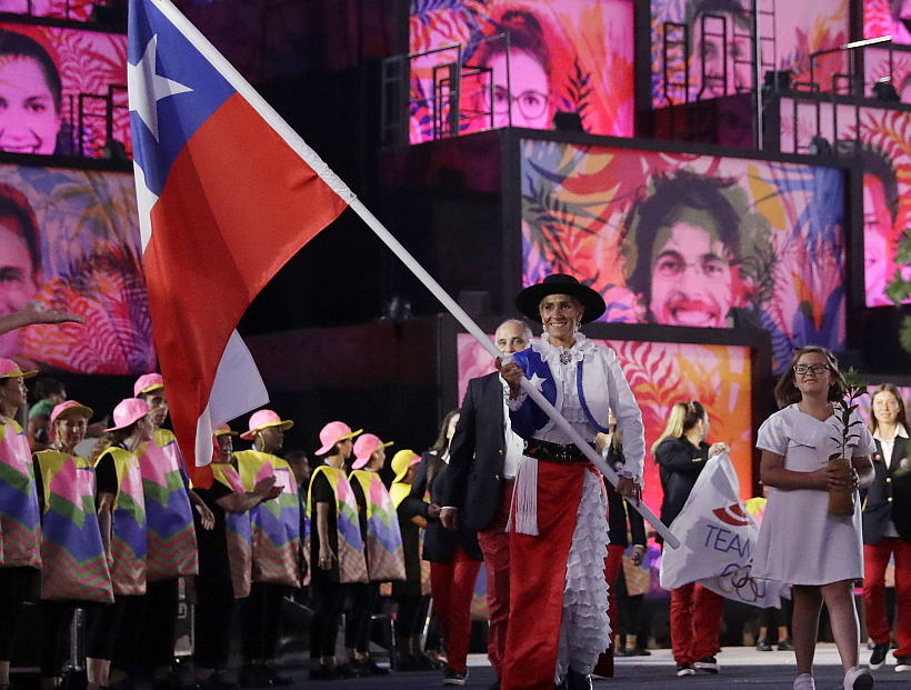 Erika Olivera carries the flag of Chile during the opening ceremony for the 2016 Summer Olympics in Rio de Janeiro, Brazil, Friday, Aug. 5, 2016. (AP Photo/Matt Dunham)