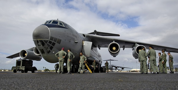 Airmen from the 15th Airlift Wing wait to board an Indian IL-76 medium cargo aircraft for a training mission with an Indian aircrew visiting Hickam Air Force Base, Hawaii, Sept. 20. (U.S. Air Force photo/Tech. Sgt. Shane A. Cuomo)